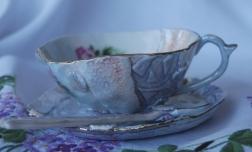 Porcelain, stains, decals glaze Cup 10x10x6 Saucer 12x12x2.5 Spoon 12 x 2.5 x1 $90
